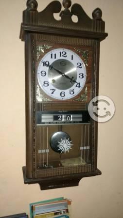 Reloj de pared dos cuerdas y péndulo