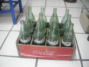 Reja De Madera Con 12 Botellas De Coca Cola De 769 Ml Vacias