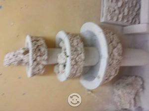 Fuentes de piedra de cantera con base y bomba