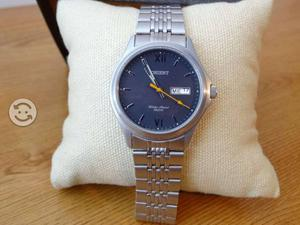 Reloj orient extensible de acero,fechador, acero i