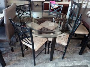 antecomedor de cristal con juego de 4 sillas