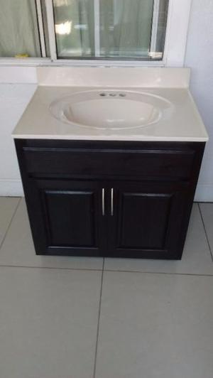 Taza y lavabo nuevos madera y granito posot class for Lavabo madera