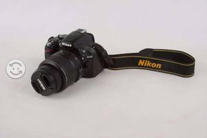 Cámara Nikon D con lente