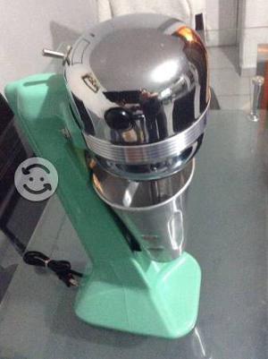 Máquina para preparar esquimos de la marca Oster