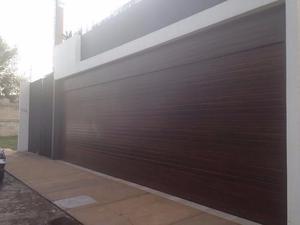 Puertas tipo americano de cochera desde pesos posot class - Puertas automaticas para cocheras ...
