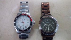 par de relojes fossil y Omax