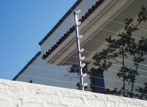 Malla electrificada y cámaras de vigilancia Cancun