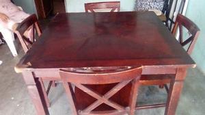 Vendo mesa de madera con cuatro sillas