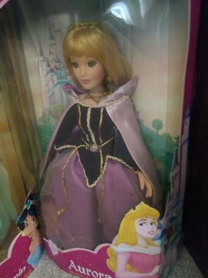 Colección de muñecas de porcelana Disney Brass Key