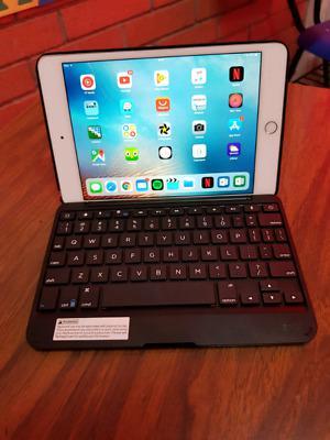 Urge Ipad mini gb con Funda tipo libro y teclado.