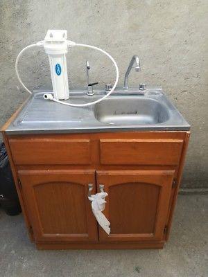 Vendo Tarja de Acero con sistema de Agua purificada y mueble