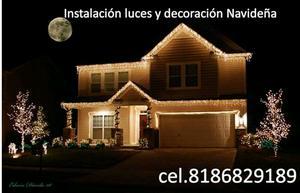 Instalación de luces navideñas y decoración exterior