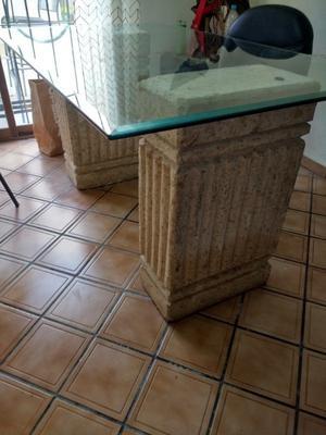 Mesa para comedor de cristal con bases de cantera