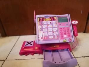 Caja registradora morada con rosa de muñecas Barbies