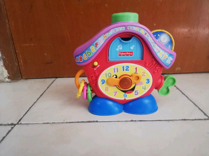 Reloj cucu fisher price para niños y bebes