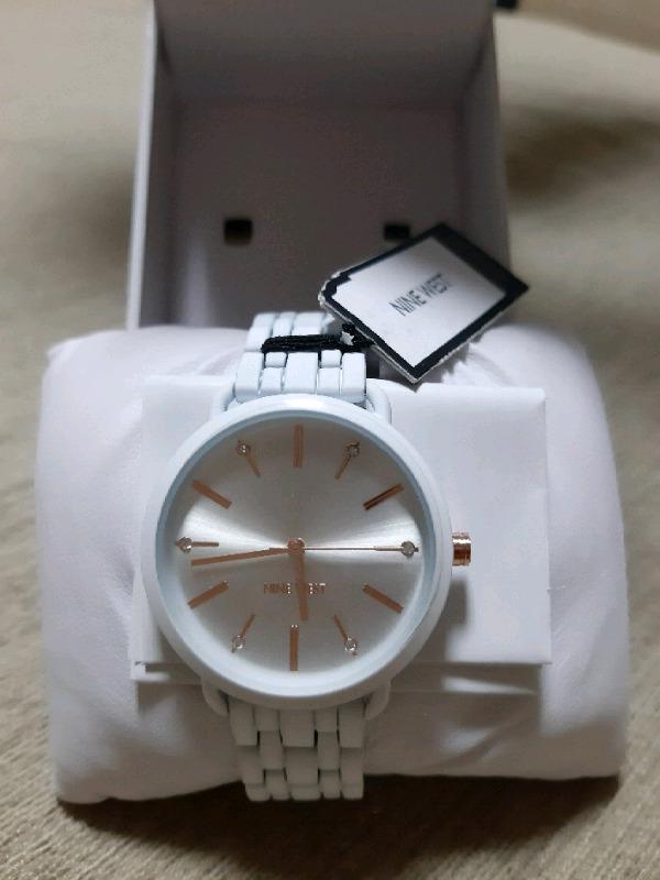 Reloj NINE WETS nuevo y original