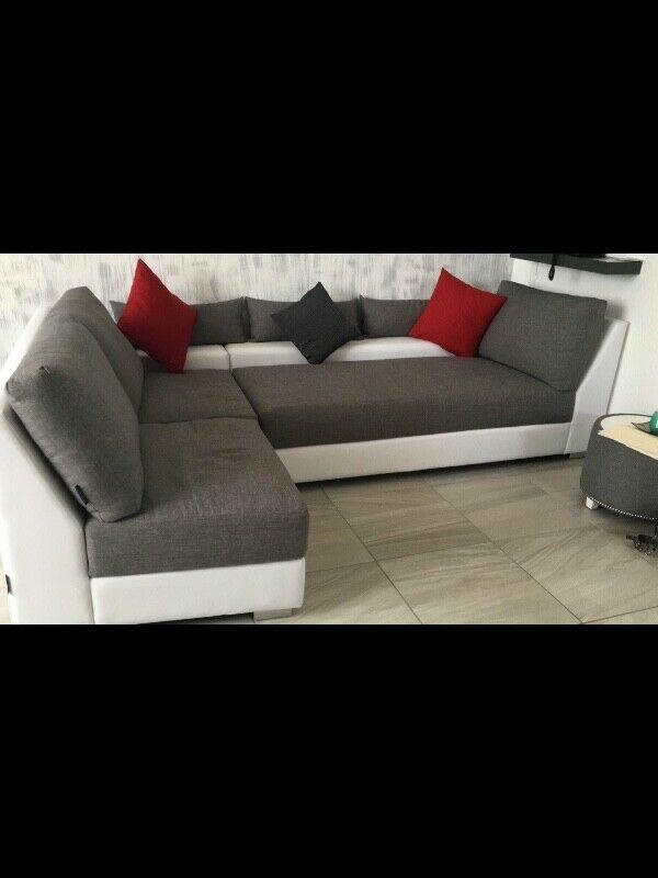 Hermosa sala color gris con blanco en forma de L de 2 piezas