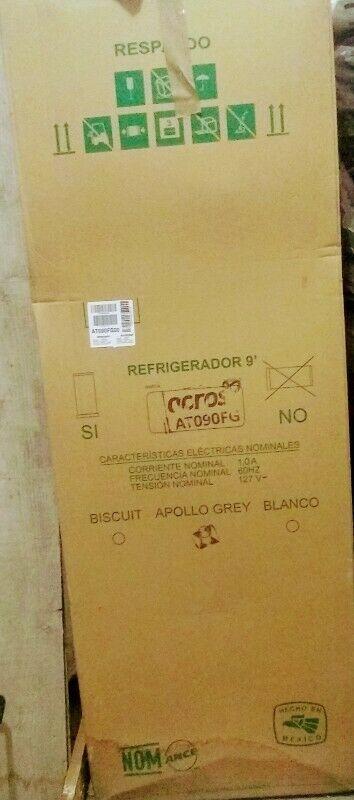 Venta de refrigerador y estufa nuevos en su caja