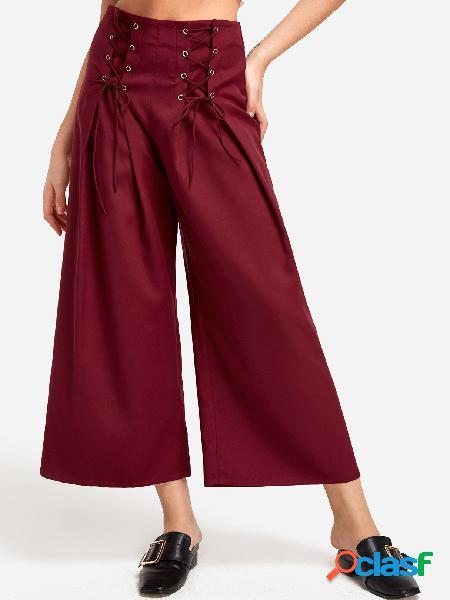 Pantalones anchos de talle medio con cordones y diseño de