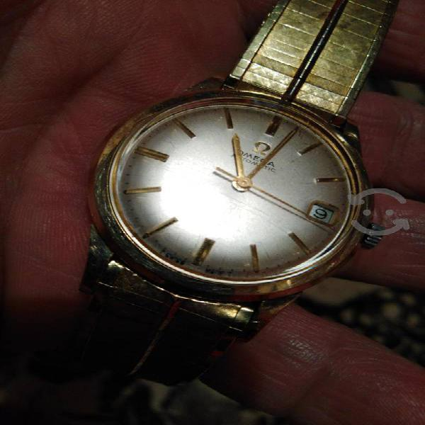 vendo o cambio reloj Omega automático calibre 561