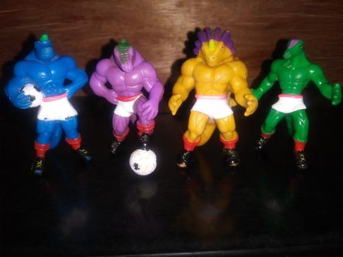 Coleccion De 4 Dinosaurios En Forma De Futbolistaa De Boing.