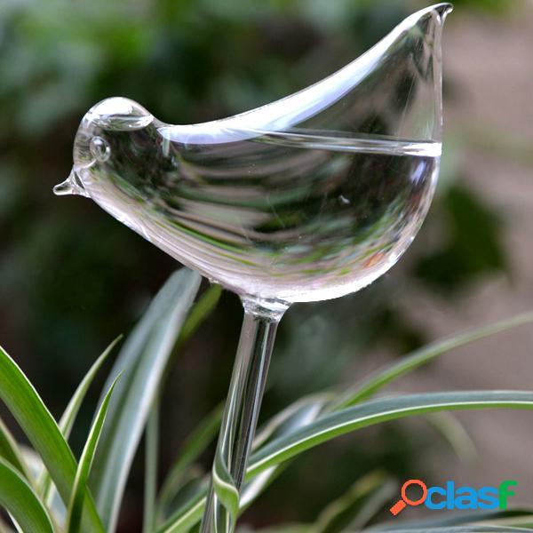 Pájaro en forma de vidrio de la planta de flores de