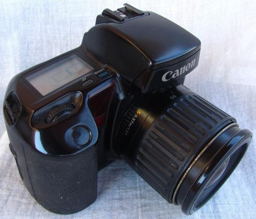 Canon Cámara 0t2.. Fotos Eos Elan Con Lente  Rollo