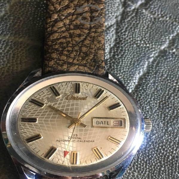 Antiguo reloj Orient de cuerda