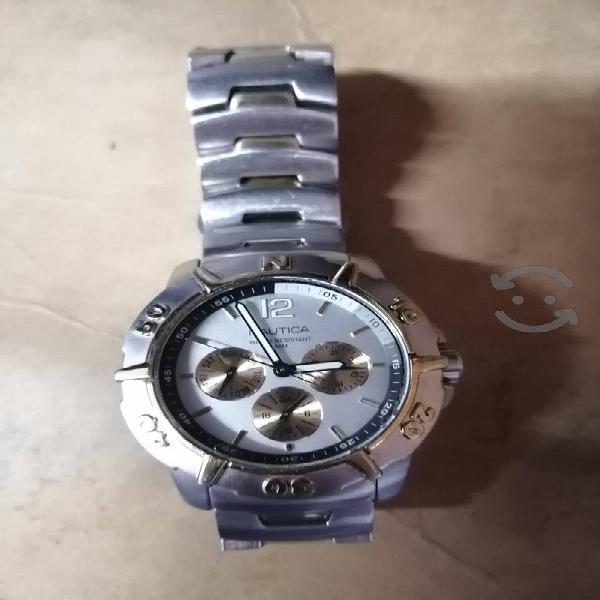 vendo reloj nautica pila nueva y empaque nuevo