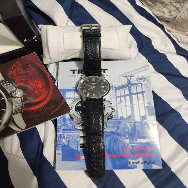 reloj tissot con correa de piel, todo original