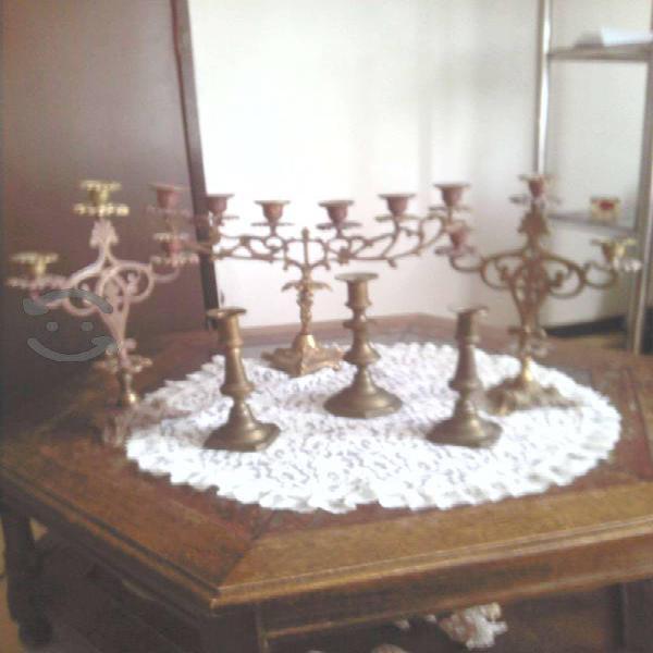 candelabros y porta velas de latón