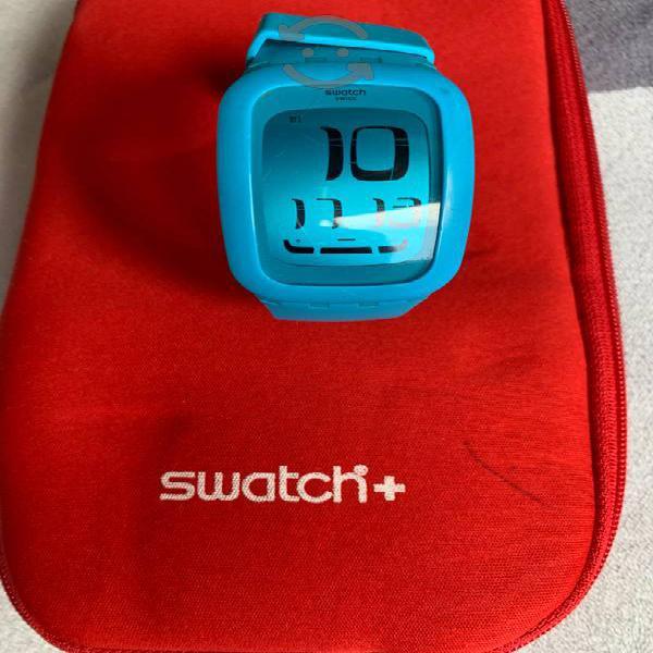 Reloj swatch touch y funda para relojes