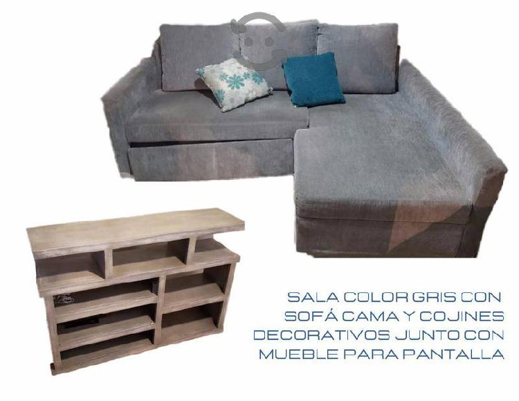 Sala con sofá cama y mueble para pantalla
